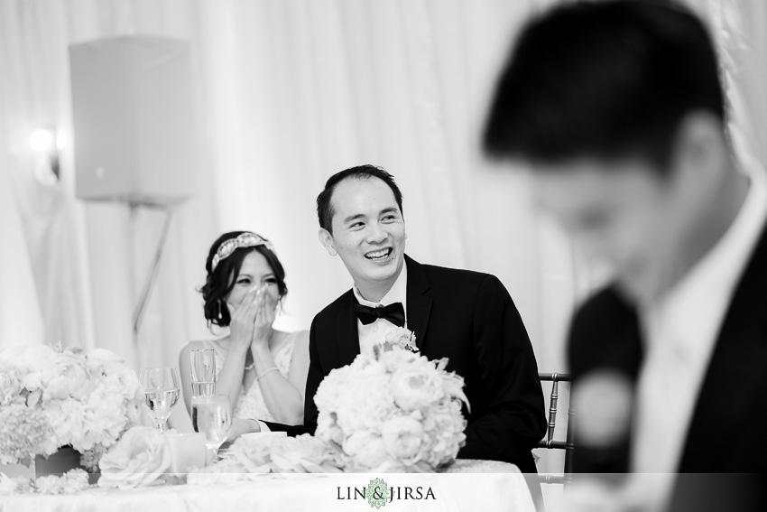 25-st-regis-monarch-beach-wedding-photographer-wedding-toast