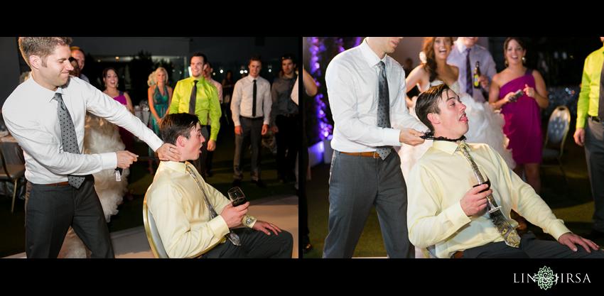 31-the-london-west-hollywood-hotel-wedding-photographer-garter-toss