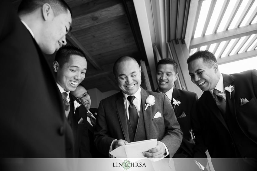 08-pelican-hill-resort-newport-beach-wedding-photographer-groom-wedding-present
