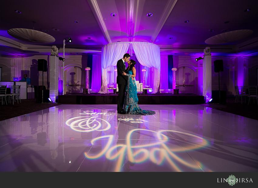 12-hilton-irvine-wedding-photographer-bride-and-groom-portraits-on-the-dance-floor