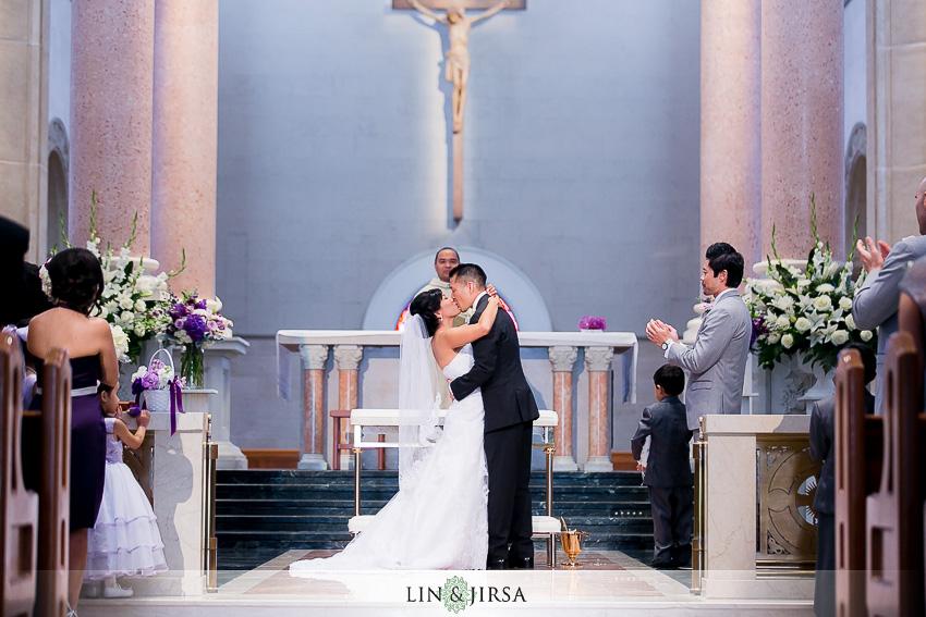 15-manchester-grand-hyatt-san-diego-wedding-photographer-bride-and-groom-first-kiss