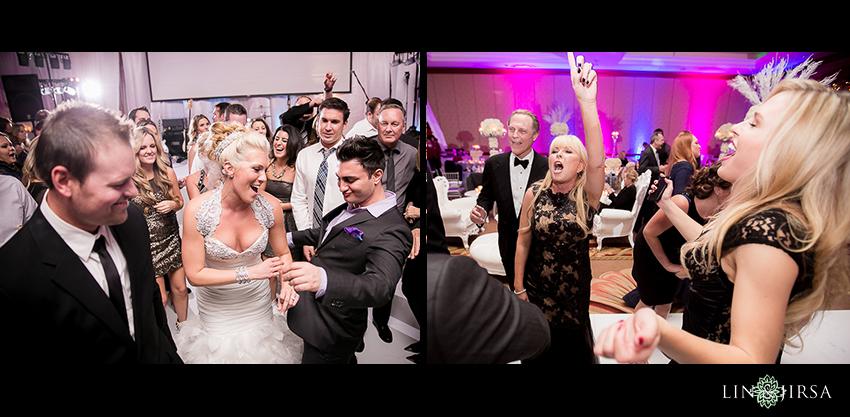 22-balboa-bay-club-newport-beach-wedding-photography-fun-dancing-shots