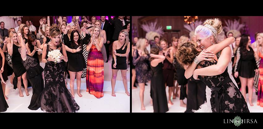 26-balboa-bay-club-newport-beach-wedding-photography-bouquet-toss