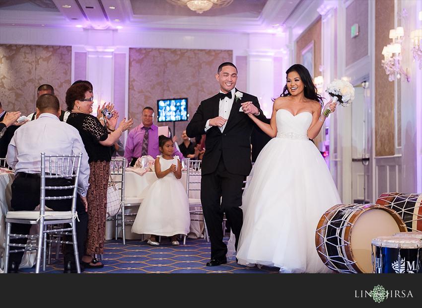 18-jw-marriott-ihilani-ko-olina-hawaii-wedding-photographer-grand-entrance
