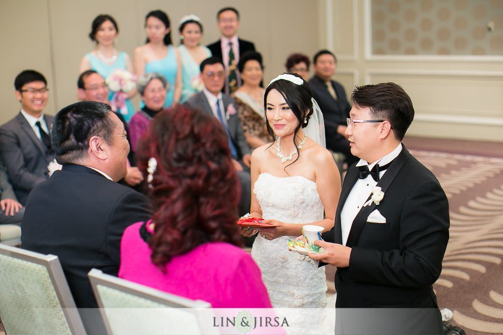 11-the-ritz-carlton-laguna-niguel-wedding-photographer-tea-ceremony-wedding-ceremony-photos