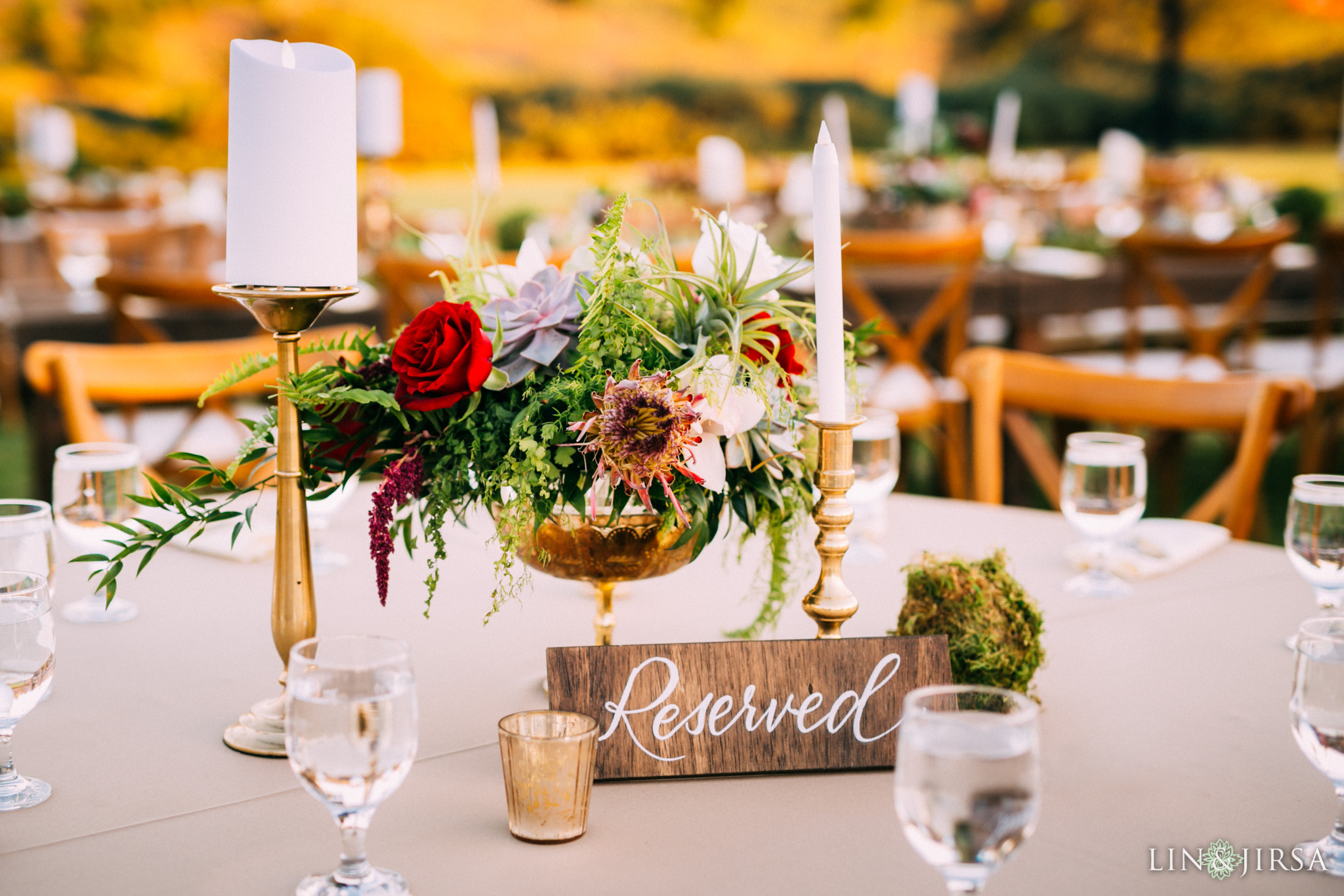 ethereal open air resort wedding reception table setting details reserved